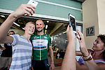 Tom Boonen (BEL) Etixx-Quick Step poses for photographs with fans at sign on before the start of Stage 2, The Capital Stage, of the 2015 Abu Dhabi Tour running 129 km from Yas Marina Circuit to Yas Mall, Abu Dhabi. 9th October 2015.<br /> Picture: ANSA/Angelo Carconi | Newsfile