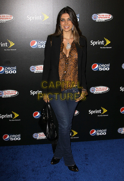 BRITTNY GASTINEAU .Auto Club Speedway Celebrates The Pepsi 500held At The Roosevelt Hotel, Hollywood, California, USA, .full length black jacket blazer brown jeans leopard print animal shirt blouse .CAP/ADM/KB.©Kevan Brooks/AdMedia/Capital Pictures.