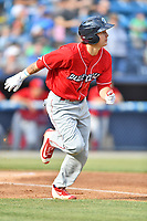 Lakewood BlueClaws center fielder Mickey Moniak (22) runs to first base during a game against the  Asheville Tourists at McCormick Field on June 3, 2017 in Asheville, North Carolina. The Tourists defeated the BlueClaws 10-7. (Tony Farlow/Four Seam Images)
