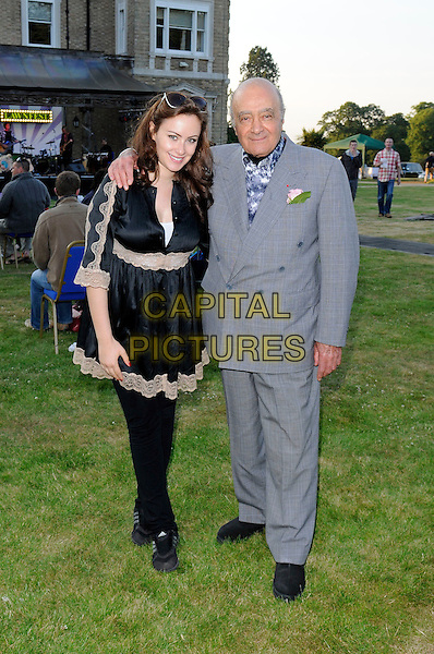"CAMILLA AL FAYED & MOHAMED AL FAYED.At ""Lawnfest"", an open air concert, West Heath School, Sevenoaks, Kent, England..June 25th, 2009.full length mohammed grey gray suit black dress father dad daughter family beige lace jeans denim .CAP/FIN.©Steve Finn/Capital Pictures."