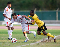 Omar Holness (9) of Jamaica tries to stop Bryan Santamaria (17) of Panama during the third place game of the CONCACAF Men's Under 17 Championship at Catherine Hall Stadium in Montego Bay, Jamaica. Panama defeated Jamaica, 1-0.