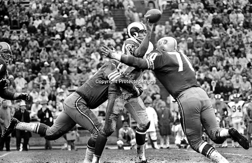 San Francisco 49ers hit Los Angeles quarterback Roman Gabriel, #70 Charlie Krueger.(1966 photo by Ron Riesterer)