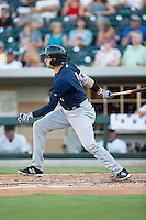 Jake Cave (8) of the Scranton/Wilkes-Barre RailRiders follows through on his swing against the Charlotte Knights at BB&T BallPark on July 20, 2016 in Charlotte, North Carolina.  The RailRiders defeated the Knights 14-2.  (Brian Westerholt/Four Seam Images)