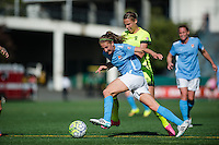 Seattle, WA - Sunday, April 17, 2016: Sky Blue FC midfielder Sarah Killion (14) drives the ball past Seattle Reign FC midfielder Merritt Mathias (9). Sky Blue FC defeated the Seattle Reign FC 2-1 during a National Women's Soccer League (NWSL) match at Memorial Stadium.