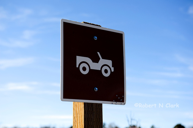 Sign of a Jeep warning that the road ahead is recommended for Jeep type vehicles