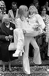 Caxton Hall Westminster London. Londons main register office untill 1979. White wedding his and her uni sex clothes, trouser suits, flares or bell bottoms, and cuban healed shoes. Long hair. 1970s fashionable London...<br /> He is Michael Stephens I think a well know hairdresser of the time. If you know otherwise please let me know.