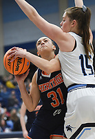 Heritage Aleyshka Pabón (31) drives the ball past Har-Ber forward Sophie Nelson (15), Friday, February 7, 2020 during a basketball game at Wildcat Arena at Har-Ber High School in Springdale. Check out nwaonline.com/prepbball/ for today's photo gallery.<br /> (NWA Democrat-Gazette/Charlie Kaijo)