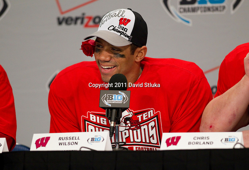 Wisconsin Badgers quarterback Russell Wilson (16) talks to reporters after winning the Big Ten Conference Championship NCAA college football game against the Michigan State Spartans on December 3 , 2011 in Indianapolis, Indiana. The Badgers won 42-39. (Photo by David Stluka)