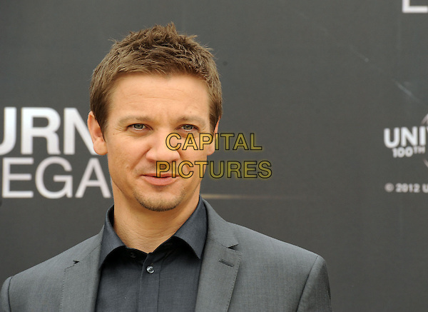 Jeremy Renner .'The Bourne Legacy' photocall, Rome, Italy..July 16th, 2012.grey gray suit jacket black shirt headshot portrait goatee facial hair stubble.CAP/IPP.©IPP/Capital Pictures.