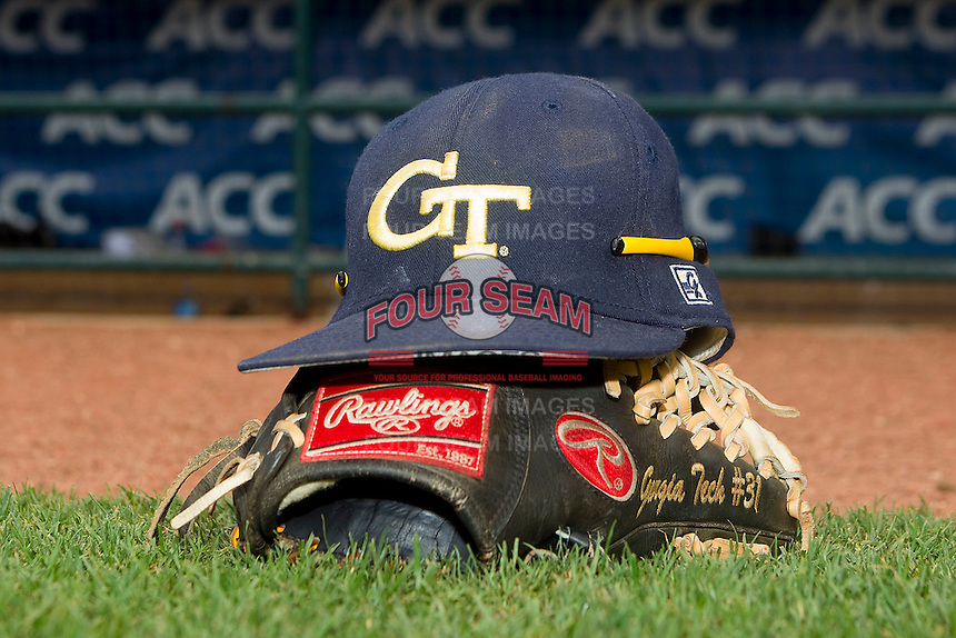 A Georgia Tech Yellow Jackets cap sits on top of a baseball glove following the game against the Miami Hurricanes at the 2012 ACC Baseball Championship at NewBridge Bank Park on May 27, 2012 in Winston-Salem, North Carolina.  The Yellow Jackets defeated the Hurricanes 8-5.  (Brian Westerholt/Four Seam Images)
