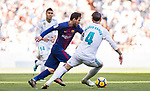 Lionel Andres Messi (L) of FC Barcelona battles for the ball with Sergio Ramos of Real Madrid during the La Liga 2017-18 match between Real Madrid and FC Barcelona at Santiago Bernabeu Stadium on December 23 2017 in Madrid, Spain. Photo by Diego Gonzalez / Power Sport Images