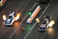Jan. 20, 2012; Jupiter, FL, USA: Aerial view as NHRA funny car driver Tim Wilkerson (left) races alongside John Force during testing at the PRO Winter Warmup at Palm Beach International Raceway. Mandatory Credit: Mark J. Rebilas-