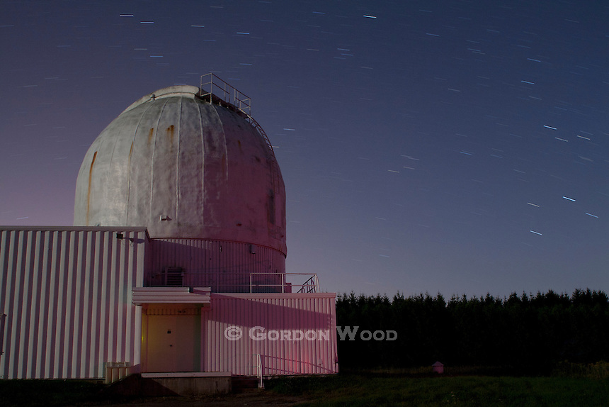 Observatory Dome with Star Trails and Illuminated by Moonrise