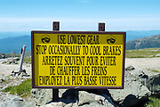 Use lowest gear sign on the autoroad near the summit of Mount Washington during the summer months in the scenic landscape of the White Mountains, New Hampshire USA