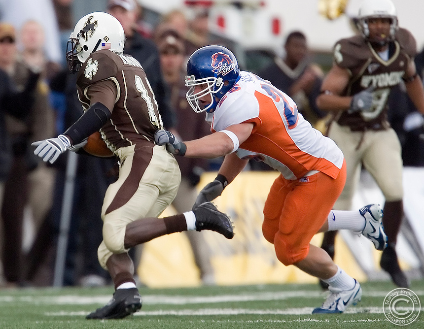 16 September 2006: Boise State linebacker Kory Hall runs down a Wyoming running back in the Broncos 17-10 victory over the Cowboys in Memorial Stadium in Laramie Wyoming.