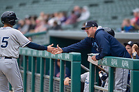 Columbus Clippers hitting coach Andy Tracy (28) congratulates Ryan Flaherty (15) during an International League game against the Indianapolis Indians on April 30, 2019 at Victory Field in Indianapolis, Indiana. Columbus defeated Indianapolis 7-6. (Zachary Lucy/Four Seam Images)