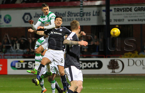 05.04.2016. Dens Park, Dundee, Scotland. Scottish Football Premiership Dundee versus Celtic. Mikael Lustig heads towards goal . The game ended in a dull 0-0 draw.