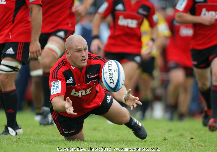 Ben Franks pops a pass up during the Super 15 rugby pre-season match between Hurricanes v Crusaders at Mangatainoka RFC, Mangatainoka, Wairarapa, New Zealand on Saturday, 11 February 2012. Photo: Dave Lintott / lintottphoto.co.nz