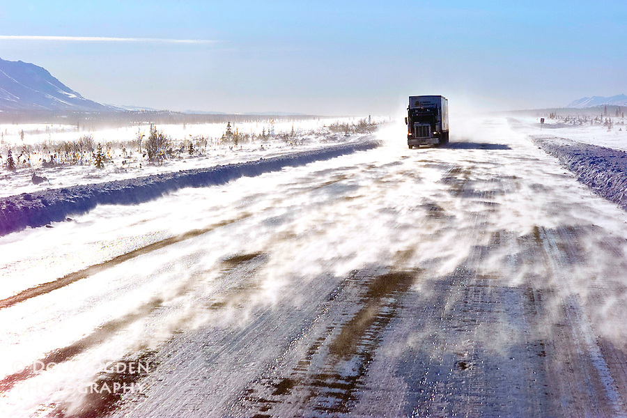 Blowing snow on ice covered highway, Broad Pass, Alaska