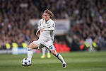 Luka Modric of Real Madrid runs with the ball during the match Real Madrid vs Napoli, part of the 2016-17 UEFA Champions League Round of 16 at the Santiago Bernabeu Stadium on 15 February 2017 in Madrid, Spain. Photo by Diego Gonzalez Souto / Power Sport Images