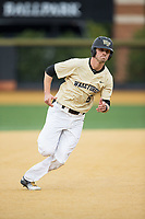 Jake Mueller (6) of the Wake Forest Demon Deacons hustles towards third base against the Georgia Tech Yellow Jackets at David F. Couch Ballpark on March 26, 2017 in  Winston-Salem, North Carolina.  The Demon Deacons defeated the Yellow Jackets 8-4.  (Brian Westerholt/Four Seam Images)