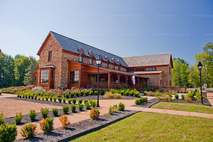 The New Kent Winery is a distinctive, large brick building set amid attractive gardens, with porches on each end of a tasting room and shop.
