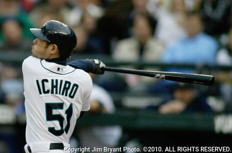 Seattle Mariners Ichiro Suzuki watches the flight of his hit into right field in the first inning of their major league game against the Philadelphia Phillies at Safeco Field in Seattle on  June 14, 2005. Suzuki with 1000 hits is just the third major leaguer since 1900 to reach 1,000 hits in less than 700 games.     Jim Bryant Photo. ©2010. All Rights Reserved
