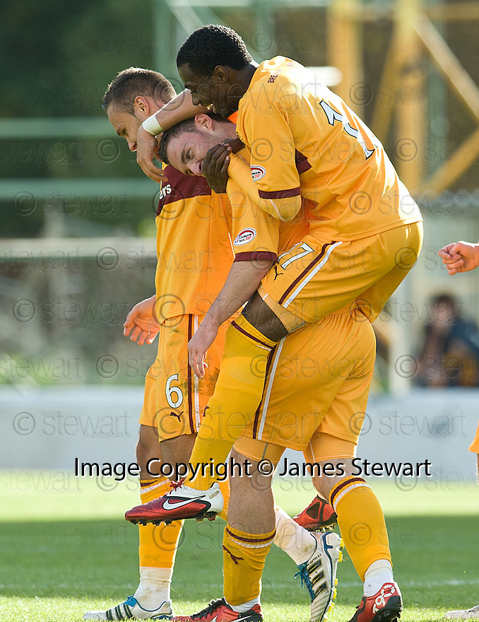 MOTHERWELL'S ROBERT MCHUGH IS CONGRATULATED BY OMAR DALEY AFTER HE SCORES MOTHERWELL'S WINNING GOAL