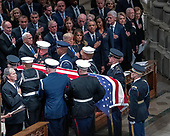 The Honor Guard carrying the casket containing the remains of former United States President George H.W. Bush is carried out of the Washington National Cathedral at the conclusion of the National funeral service in honor of the late former President in Washington, DC on Wednesday, December 5, 2018.  Al lower left is former US President George W. Bush.  also visible, in the front row: US President Donald J. Trump, first lady Melania Trump, former US President Barack Obama, former first lady Michelle Obama, former US President Bill Clinton, former US Secretary of State Hillary Rodham Clinton, former US President Jimmy Carter, and former first lady Rosalynn Carter.  In the second row are US Vice President Mike Pence, Karen Pence, former US Vice President Dan Quayle, Marilyn Quayle, former United States Vice President Dick Cheney, former United States Vice President Joe Biden and Jill Biden.<br /> Credit: Ron Sachs / CNP<br /> (RESTRICTION: NO New York or New Jersey Newspapers or newspapers within a 75 mile radius of New York City)