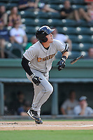 Third baseman Billy Fleming (8) of the Charleston RiverDogs bats in a game against the Greenville Drive on Friday, August 14, 2015, at Fluor Field at the West End in Greenville, South Carolina. Charleston won 6-2. (Tom Priddy/Four Seam Images)