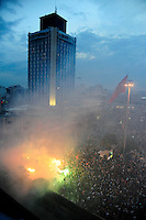 Supporters of the Besiktas football team light flares in Taksim Square, Tuesday, June 4, 2013, in Istanbul, Turkey. (Seamus Travers/pressphotointl.com)