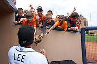 Akron RubberDucks pitcher Jacob Lee signs autographs for young fans after a game against the New Britain Rock Cats on May 21, 2015 at Canal Park in Akron, Ohio.  Akron defeated New Britain 4-2.  (Mike Janes/Four Seam Images)