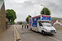Police at the scene in Brithweunydd Road<br /> Re: A woman has been arrested after a child was found dead at a property in Trealaw, Rhondda, Wales, UK.<br /> The woman, aged 37, was detained when emergency services were called to an address in the town at about 10.20am on Friday.<br /> The death is being treated as unexplained.<br /> As part of the investigation, the main route through Trealaw, Brithweunydd Road, has been closed off.