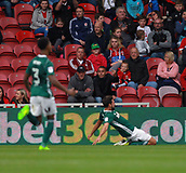 30th September 2017, Riverside Stadium, Middlesbrough, England; EFL Championship football, Middlesbrough versus Brentford; Yoann Barbet of Brentford slides on his knees after putting Brentford 0-1 ahead