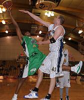 Jets import Daryl Hudson lays a shot up under pressure from Lance Allred. NBL  - Manawatu Jets  v Otago Nuggets at Arena Manawatu, Palmerston North, New Zealand on Sunday 5 June 2011. Photo: Dave Lintott / lintottphoto.co.nz