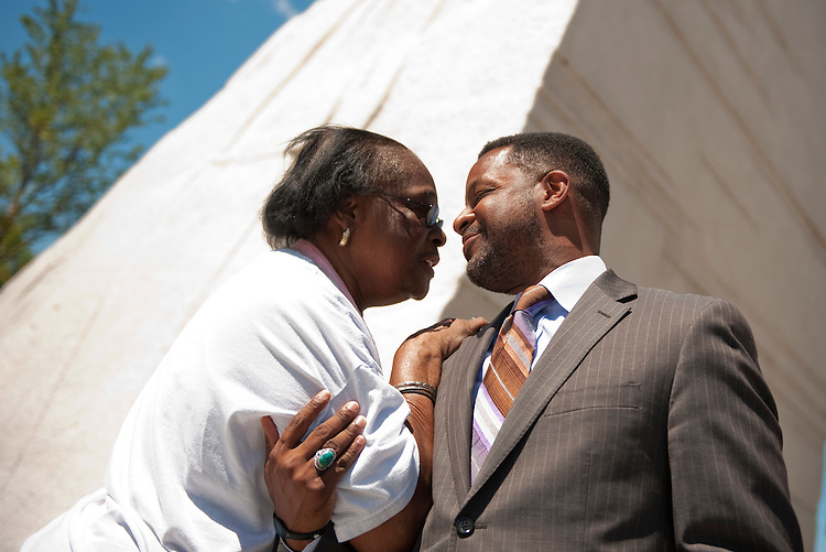 UNITED STATES - AUGUST 23:  DC Council Chairman Kwame Brown greets Marilyn M. Simmons of Chillum, Md., at the entrance of the Martin Luther King Jr. Memorial.  The memorial, located on the Tidal Basin, is open to viewing by the public and the official dedication ceremony will take place on August 28.  (Photo By Tom Williams/Roll Call)