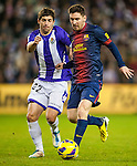 VALLADOLID, SPAIN - DECEMBER 22:  Lionel Messi (R) of Barcelona fights for the ball with Victor Perez of Valladolid during the La Liga game between Real Valladolid and FC Barcelona at Jose Zorrilla on December 22, 2012 in Valladolid, Spain. Photo by Victor Fraile / The Power of Sport Images