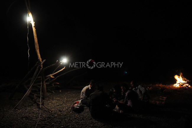 CHUMI GOALEYA, IRAQ: Fisherman play dominoes at night.  The following morning they will check their nets for the night's catch.<br /> <br /> Fishermen high in the Kurdish mountains use nets to catch river fish.  <br /> <br /> Photo by Pazhar Muhammed