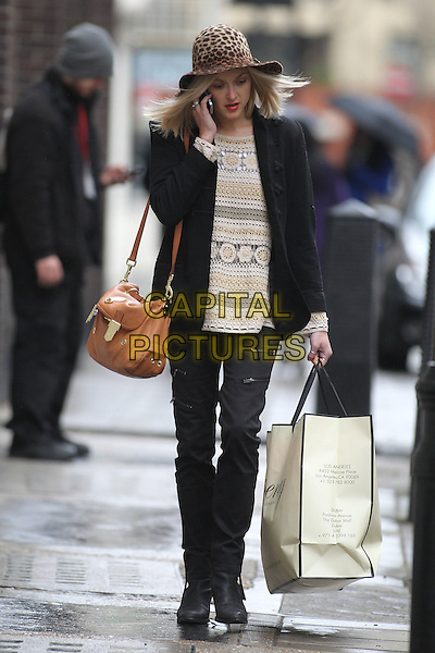 Fearne Cotton leaving the BBC Radio 1 studios, London, England..January 20th, 2011.full length black coat jacket trousers brown leopard print hat white cream beige top bag purse talking on mobile phone crochet.CAP/CAN.©Can Nguyen/Capital Pictures.
