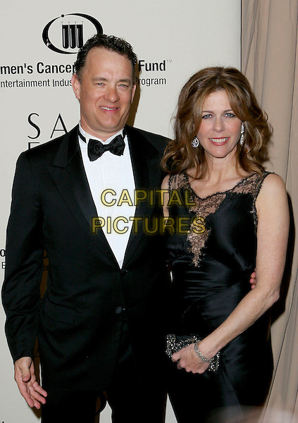 TOM HANKS & RITA WILSON.Saks Fifth Avenue's Unforgettable Evening.Benefiting Women's Cancer Research Fund.held at the Regent Beverly Wilshire Hotel, Beverly Hills, USA, 1st March 2005..half length black dress lace sheer see through see-through thru see-thru.Ref: ADM.www.capitalpictures.com.sales@capitalpictures.com.©JWong/AdMedia/Capital Pictures .