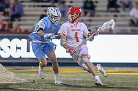 College Park, MD - April 27, 2019: Maryland Terrapins attack Jared Bernhardt (1) avoids a check by a John Hopkins Bluejays defender during the game between John Hopkins and Maryland at  Capital One Field at Maryland Stadium in College Park, MD.  (Photo by Elliott Brown/Media Images International)