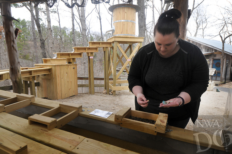 NWA Democrat-Gazette/BEN GOFF @NWABENGOFF<br /> Lexi Hogye of Fort Worth, Texas tries her hand at panning for gemstones on Thursday March 17, 2016 at War Eagle Cavern on Beaver Lake near Rogers. The cavern opened for the season on Saturday and offers guided tours highlighting the human and natural history of the cave each day through November. The gemstone panning area is one of several new above-ground attractions at the cavern this season.