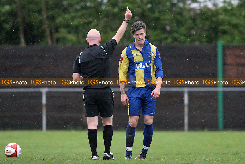 Joe Bingham of Romford receives a yellow card from referee Magill - Great Wakering Rovers vs Romford - Ryman League Division One North Football at Burroughs Park - 28/04/12 - MANDATORY CREDIT: Gavin Ellis/TGSPHOTO - Self billing applies where appropriate - 0845 094 6026 - contact@tgsphoto.co.uk - NO UNPAID USE.