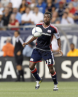 New England Revolution midfielder Clyde Simms (19) controls the ball. In a Major League Soccer (MLS) match, the New England Revolution defeated Columbus Crew, 2-0, at Gillette Stadium on September 5, 2012.