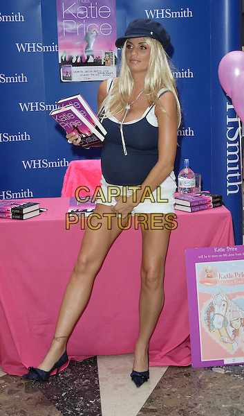 "KATIE PRICE aka JORDAN.At a signing for her new novel ""Crystal"" at WH Smith, Lakeside Shopping Centre, England, .June 9th 2007..Booksigning full length pregnant navy blue vest top white shorts cap hat shoes ankle tattoo book itching scratching funny.CAP/ROS.©Steve Ross/Capital Pictures"