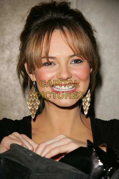 KARA TOINTON.Mad Hatters Tea Party - Annual event for children of London put on by the London Taxi Drivers Fund for Underprivilieged Children, Grosvenor House Hotel, Park Lane, London, England, January 20th 2008.portrait headshot gold earrings .CAP/ROS.©Steve Ross/Capital Pictures