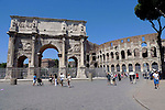 The arch of Constantine and the outer wall of the Colosseum in the Monti district of Rome.