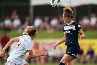 Sky Blue FC midfielder Sophie Schmidt (16) heads the ball as FC Kansas City defender Lauren Sesselmann (14) watches. Sky Blue FC and FC Kansas City played to a 2-2 tie during a National Women's Soccer League (NWSL) match at Yurcak Field in Piscataway, NJ, on June 26, 2013.