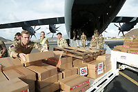 British Royal Marine Commandos help unload food aid for people affected by Hurricane Irma on the British Virgin Island of Tortola, on 10 Sept 2017.