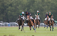 Marcos Di Paola (King Power) holds off Juan Gris Zaveleta (Salkeld) during the Cartier Queens Cup Final match between King Power Foxes and Dubai Polo Team at the Guards Polo Club, Smith's Lawn, Windsor, England on 14 June 2015. Photo by Andy Rowland.